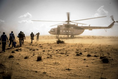 UN peacekeepers return to their helicopter following a mission to the village of Sobane Da in the Mopti region of Mali.