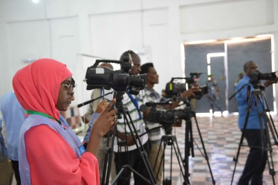 Journalists cover the electoral process in Mogadishu, Somalia on December 4, 2016.