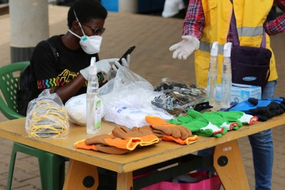 A woman selling hand sanitiser, gloves and face masks in Kigali (file photo).