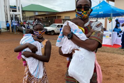 Some of the beneficiaries of a WHO campaign that saw the mass distribution of 4.6 million long-lasting, insecticide-treated bed nets in Sierra Leone's capital city, Freetown and its suburbs.