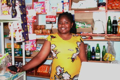 Elizabeth Jeremiah, a 24-year old business owner, wife and mother of twins, has a shop called Network Shop in Kiganjo Thika on the outskirts of Nairobi, which she almost closed down due to COVID-19 financial hardships.