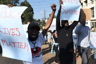 Protesters march during a demonstration in solidarity with the global Black Lives Matter protests over police brutality and white supremacy in the U.S., outside the US Embassy in Nairobi on June 2.