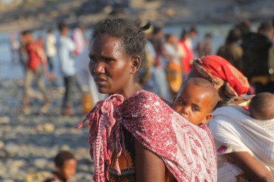 Ethiopian refugees fleeing clashes in the Tigray region cross the border into Sudan.