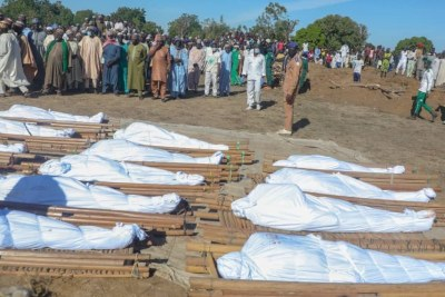 Hundreds of residents mourned as they gathered to bury corpses of 43 farmers slaughtered in Zabarmari village, a rice-producing community located in Borno State