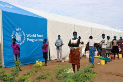 Refugees wait to collect food at a centre in Kakuma camp in Kenya (file photo).