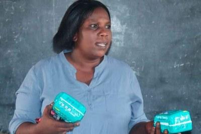 Milcah Hadida training girls on menstrual hygiene.