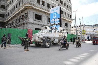 Police officers serving under the African Union Mission in Somalia (AMISOM) patrol a street in Mogadishu, Somalia, on May 29, 2021.