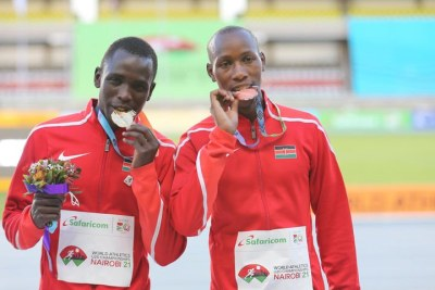 Kenya's Amos Serem (left) and Simon Koech celebrate their gold and bronze medals during the men's 3,000m steeplechase medal ceremony event during the World Under-20 Athletics Championships at Kasarani on August 22.